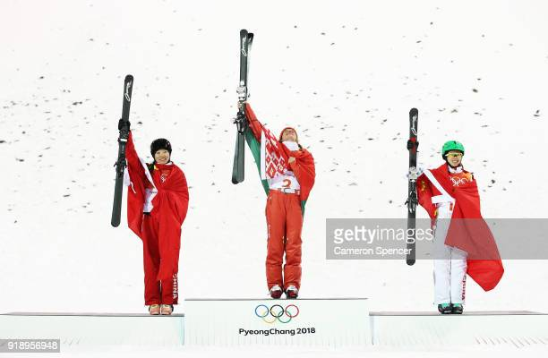 Silver medalist Xin Zhang of China and gold medalist Hanna Huskova of Belarus and bronze medalist Fanyu Kong of China pose during the victory...