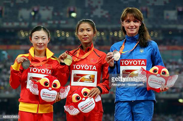 Silver medalist Xiuzhi Lu of China, gold medalist Hong Liu of China and bronze medalist Lyudmyla Olyanovska of Ukraine pose on the podium during the...