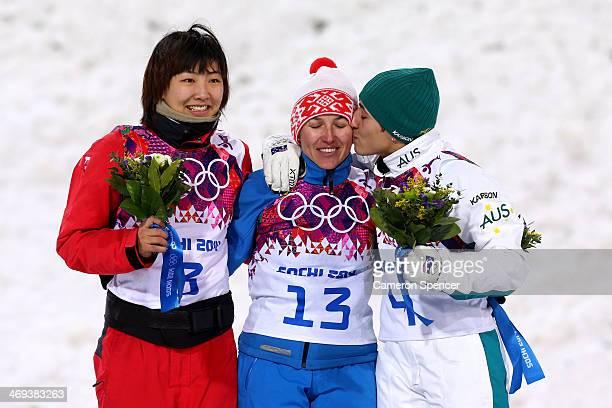 Silver medalist Xu Mengtao of China gold medalist Alla Tsuper of Belarus and bronze medalist Lydia Lassila of Australia celebrate on the podium...