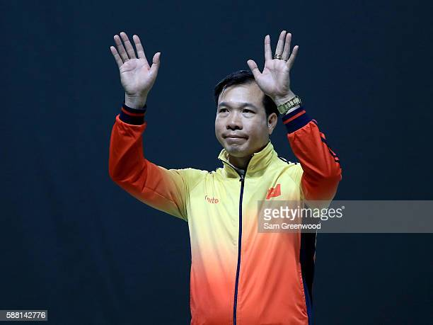 Silver medalist Xuan Vinh Hoang of Vietnam poses on the podium following the 50m pistol event on Day 5 of the Rio 2016 Olympic Games at the Olympic...