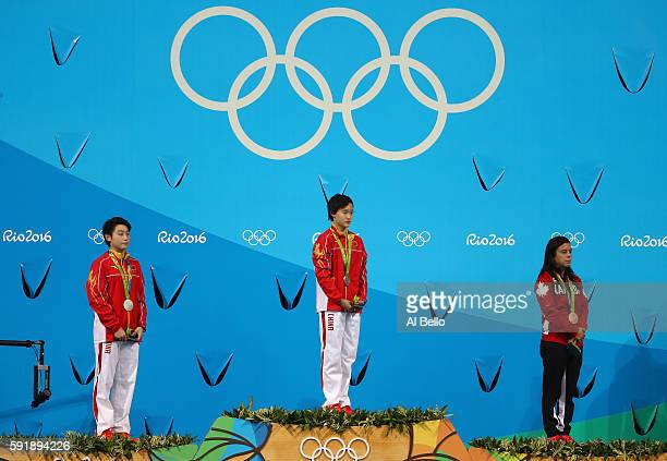 Silver medalist Yajie Si of China gold medalist Qian Ren of China and bronze medalist Meaghan Benfeito of Canada stand on the podium during the medal...