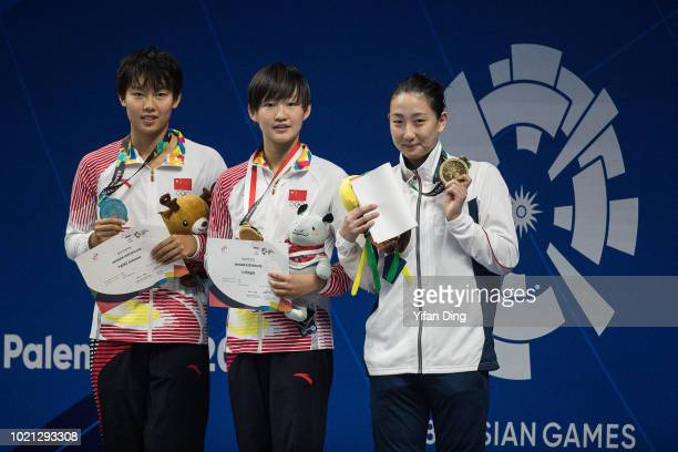 Silver medalist Yang Junxuan of China Gold medalist Li Bingjie of China and Igarashi Chihiro of Japan in action during Women's 200m Freestyle...