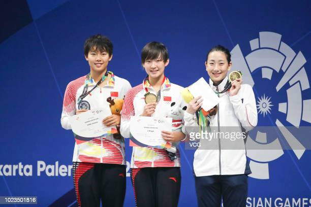 Silver medalist Yang Junxuan of China gold medalist Li Bingjie of China and bronze medalist Chihiro Igarashi of Japan pose on the podium after the...