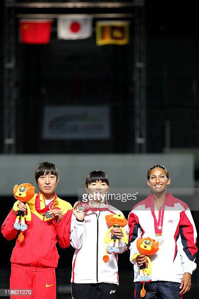 Silver medalist Yang Qi of China gold medalist Satomi Kubokura of Japan and bronze medalist Christine Sonali Merril of Sri Lanka pose after the...