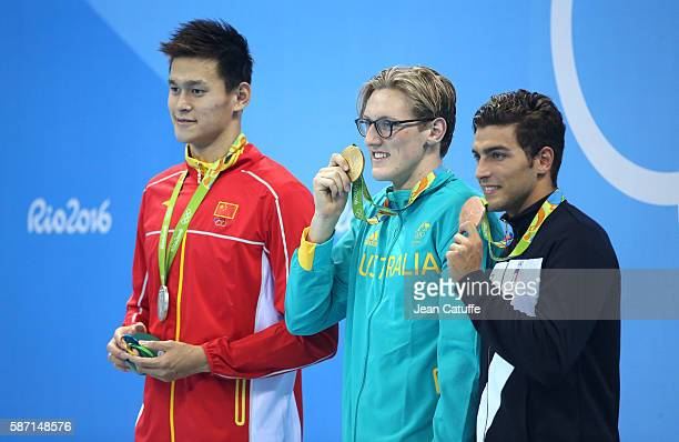Silver medalist Yang Sun gold medalist Mack Horton of Australia bronze medalist Gabriele Detti of Italy pose during the medal ceremony for the Men's...