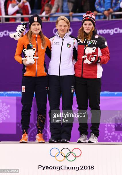 Silver medalist Yara Van Kerkhof of the Netherlands gold medalist Arianna Fontana of Italy and bronze medalist Kim Boutin of Canada celebrate during...