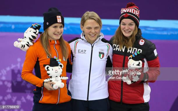 Silver medalist Yara Van Kerkhof of the Netherlands gold medalist Arianna Fontana of Italy bronze medalist Kim Boutin of Canada pose on the podium...