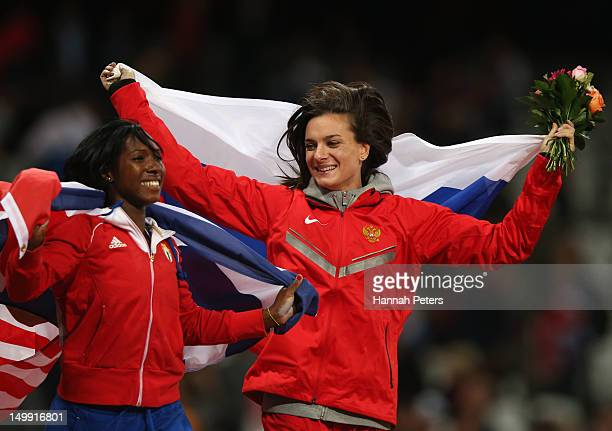 Silver medalist Yarisley Silva of Cuba and gold medalist Jennifer Suhr of the United States celebrate after the Women's Pole Vault final on Day 10 of...