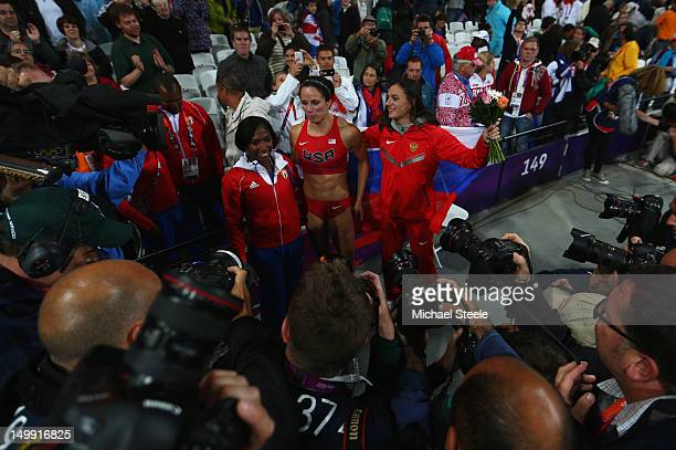 Silver medalist Yarisley Silva of Cuba gold medalist Jennifer Suhr of the United States and Elena Isinbaeva of Russia celebrate after the Women's...