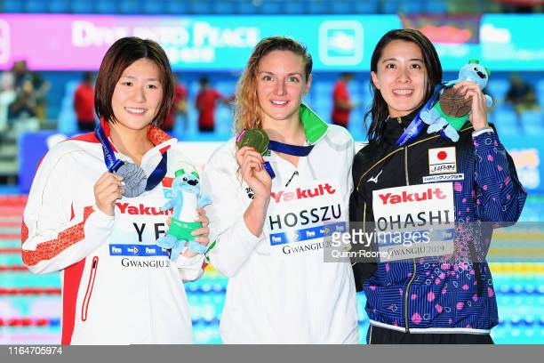 Silver medalist Ye Shiwen of China gold medalist Katinka Hosszu of Hungary and Yui Ohashi of Japan celebrate on the podium at the medal ceremony for...