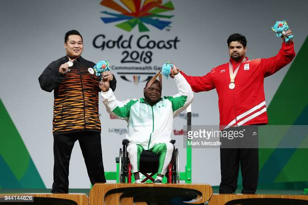 Silver medalist Yee Khie Jong of Malaysia gold medalist Abdulazeez Ibrahim of Nigeria and bronze medalist Sachin Chaudhary of India pose during the...