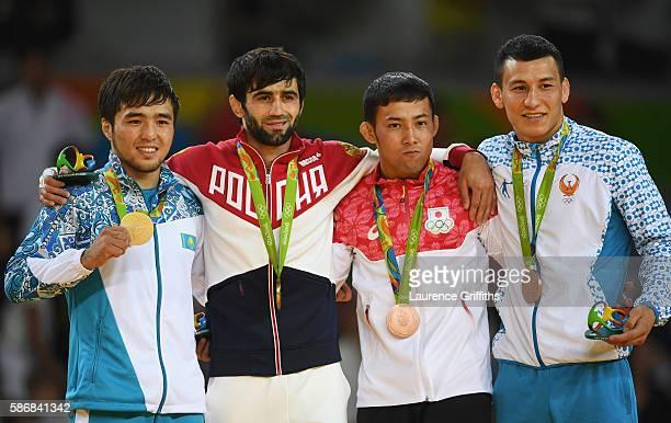 Silver medalist Yeldos Smetov of Kazakhstan, gold medalist Beslan Mudranov of Russia, bronze medalist Naohisa Takato of Japan and bronze medalist...