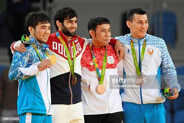 Silver medalist Yeldos Smetov of Kazakhstan, gold medalist Beslan Mudranov of Russia, bronze medalists Naohisa Takato of Japan and Diyorbek Urozboev...