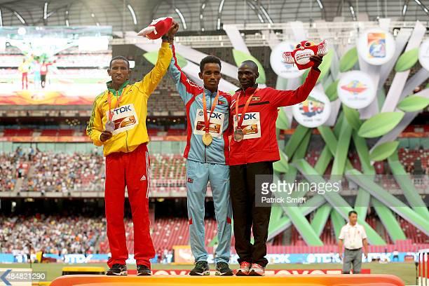 Silver medalist Yemane Tsegay of Ethiopia gold medalist Ghirmay Ghebreslassie of Eritrea and bronze medalist Munyo Solomon Mutai of Uganda pose on...