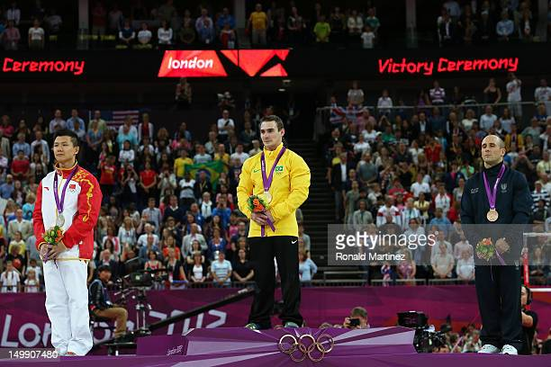 Silver medalist Yibing Chen of China gold medalist Arthur Nabarrete Zanetti of Brazil and bronze medalist Matteo Morandi of Italy pose on the podium...