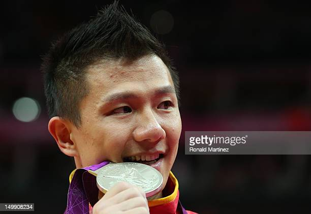 Silver medalist Yibing Chen of China poses on the podium during the medal ceremony for the Artistic Gymnastics Men's Rings on Day 10 of the London...