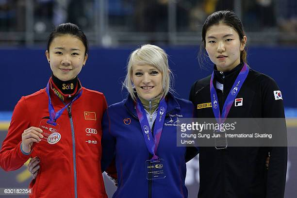 Silver medalist Yihan Guo of China gold medalist Elise Christie of Great Britain and bronze medalist Shim SukHee of South Korea celebrate during the...
