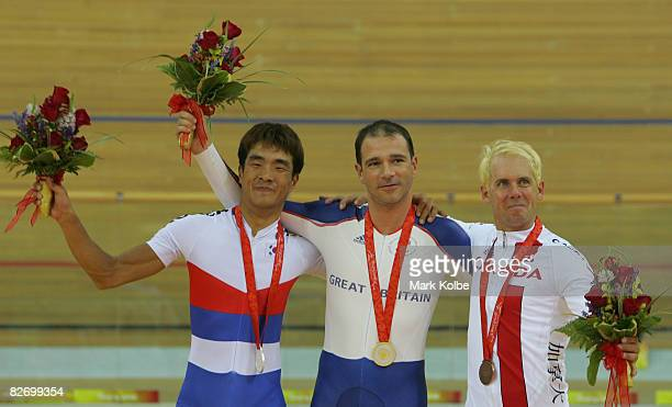 Silver medalist YongSi Jin of Korea Gold medalist Darren Kenny of Great Britain and Jean Quevillon of Canada celebrates on the podium with their...