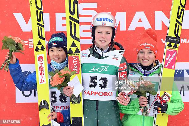 Silver medalist Yuki Ito of Japan gold medalist Maren Lundby of Norway and bronze medalist Katharina Althaus of Germany pose on the podium after the...