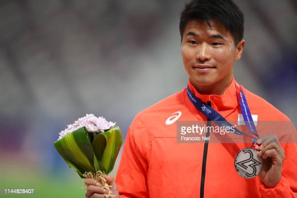 Silver medalist Yuki Koike of Japan celebrates during the medal ceremony for Men's 200m during the during Day Four of the 23rd Asian Athletics...