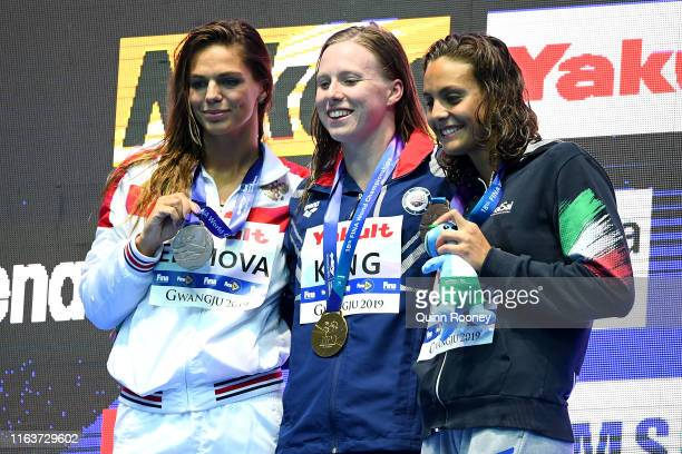 Silver medalist Yulia Efimova of Russia gold medalist Lilly King of the United States and bronze medalist Martina Carraro of Italy pose during the...