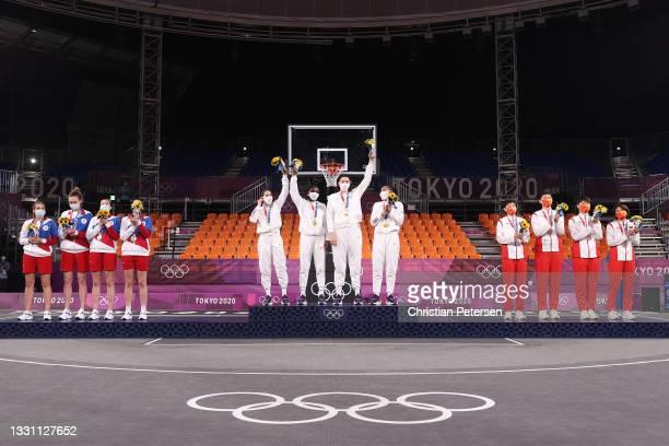 Silver medalist Yulia Kozik, Anastasiia Logunova, Evgeniia Frolkina and Olga Frolkina of Team ROC, gold medalist Kelsey Plum, Jacquelyn Young,...