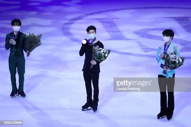 Silver medalist Yuma Kagiyama of Japan, gold medalist Nathan Chen of United States and bronze medalist Yuzuru Hanyu of Japan pose for a photo during...