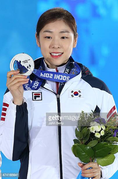 Silver medalist Yuna Kim of South Korea celebrates during the medal ceremony for the Women's Free Figure Skating on day fourteen of the Sochi 2014...