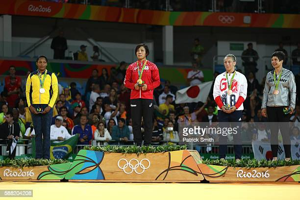 Silver medalist Yuri Alvear of Colombia gold medalist Haruka Tachimoto of Japan bronze medalist A Sally Conway of Great Britain and bronze medalist B...