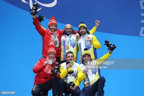 Silver medalist Yury Holub of Belarus of Belarus Gold medalist Vitaliy Luk'yanenko of Ukraine and bronze medalist Anatolii Kovalevskyi of Ukraine...