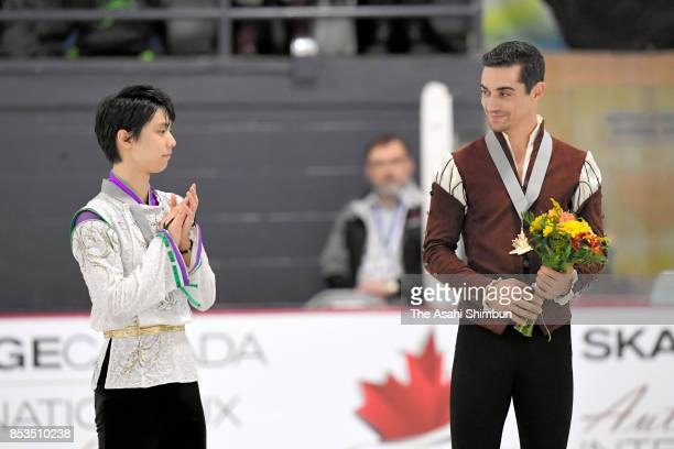 Silver medalist Yuzuru Hanyu of Japan applauds gold medalist Javier Fernandez of Spain on the podium at the medal ceremony for the Men's Singles...