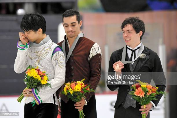 Silver medalist Yuzuru Hanyu of Japan gold medalist Javier Fernandez of Spain and bronze medalist Keegan Messing of Canada pose on the podium at the...