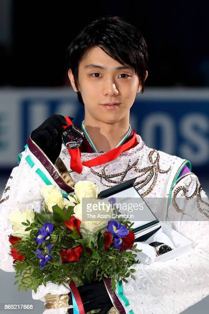 Silver medalist Yuzuru Hanyu poses on the podium at the medal ceremony for the Men's singles during day three of the ISU Grand Prix of Figure Skating...
