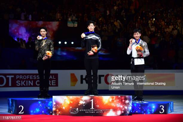 Silver medalist Yuzuru Hanyu of Japan gold medalist Nathan Chen of the United States and bronze medalist Vincent Zhou of the United States pose on...