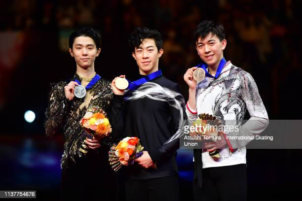 Silver medalist Yuzuru Hanyu of Japan gold medalist Nathan Chen of the United States and bronze medalist Vincent Zhou of the United States pose...