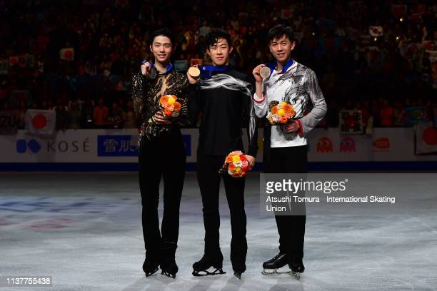 Silver medalist YuzuruHanyu of Japan, gold medalist NathanChen of the United States and bronze medalist VincentZhou of the United States pose...