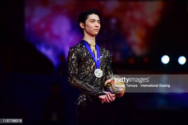 Silver medalist YuzuruHanyu of Japan stands on the podium at the medal ceremony for the Men's single on day four of the 2019 ISU World Figure...