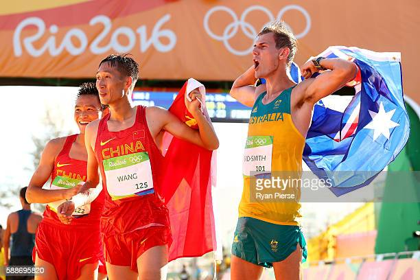 Silver medalist Zelin Cai of China, gold medalist Zhen Wang of China and bronze medalist Dane Bird-Smith of Australia celebrate after the Men's 20km...