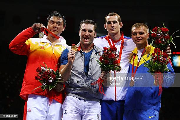 Silver medalist Zhang Zhilei of China gold medalist Roberto Cammarelle of Italy and bronze medalists David Price of Great Britain and Vyacheslav...