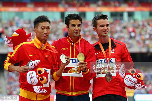 Silver medalist Zhen Wang of China gold medalist Miguel Angel Lopez of Spain and bronze medalist Benjamin Thorne of Canada pose on the podium during...