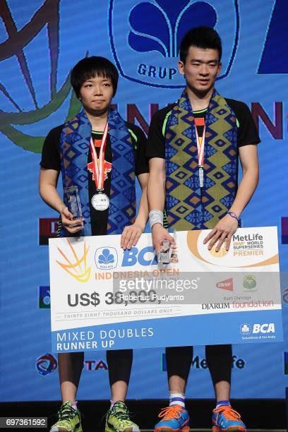 Silver medalist Zheng Siwei and Chen Qingchen of China celebrate on the podium during Mixed Double medals ceremony of the BCA Indonesia Open 2017 at...