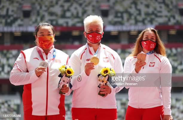 Silver medalist Zheng Wang of Team China, gold medalist Anita Wlodarczyk of Team Poland and bronze medalist Malwina Kopron of Team Poland pose during...
