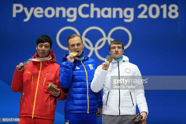 Silver medalist Zongyang Jia of China, gold medalist Oleksandr Abramenko of Ukraine and bronze medalist Ilia Burov of Olympic Athlete from Russia...