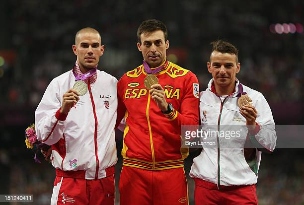 Silver medalist Zoran Talic of Croatia gold medalist Jose Antonio Exposito Pineiro of Spain and bronze medalist Lenine Cunha of Portugal poses on the...