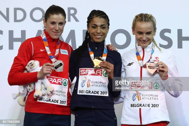 Silver medalist Zuzana Hejnova of Czech Republic gold medalist Floria Guei of France and bronze medalist Justyna Swiety of Poland pose during the...