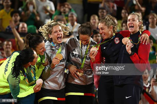 Silver medalists Agatha Bednarczuk Rippel and Barbara Seixas de Freitas of Brazil, gold medalists Laura Ludwig and Kira Walkenhorst of Germany and...