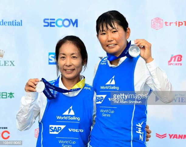 Silver medalists Ai Yoshida and Miho Yoshioka of Japan celebrate on the podium at the medal ceremony for the Women's 470 on day six of the Sailing...