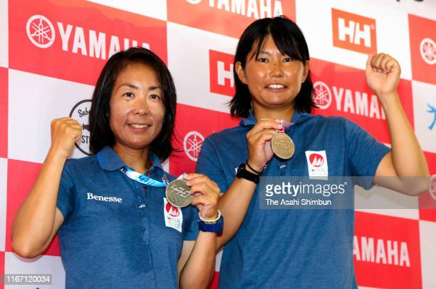 Silver medalists Ai Yoshida and Miho Yoshioka of Japan celebrate during the medal ceremony for the Women's event on day eight of the 470 World...