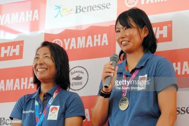 Silver medalists Ai Yoshida and Miho Yoshioka of Japan speak to media after the medal ceremony for the Women's event on day eight of the 470 World...
