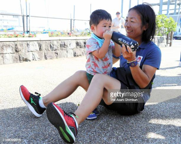 Silver medalists Ai Yoshida of Japan lets her son drinks prior to the medal ceremony for the Women's event on day eight of the 470 World...